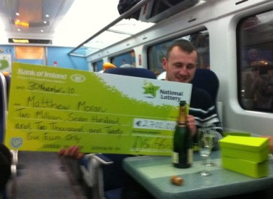 Matthew Moran celebrates his 2.7m win on the train home to Wexford yesterday