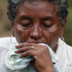 Ana Luz Acosta, a relative of miner Jorge Lara, sheds tears outside La Preciosa coal mine in Sardinata, Colombia. Lara is among 20 miners feared dead after an explosion there on Wednesday.
