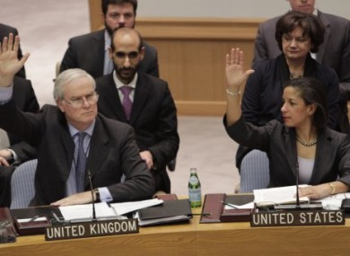 British Ambassador to the United Nations Mark Lyall Grant and American Ambassador Susan Rice vote.