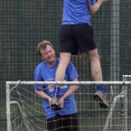 Cllr Aidan Culhane, below, helps Fianna Fail TD Barry Andrews retrieve a ball from the netting during the Newstalk General Election charity football match in aid of Barnardos.