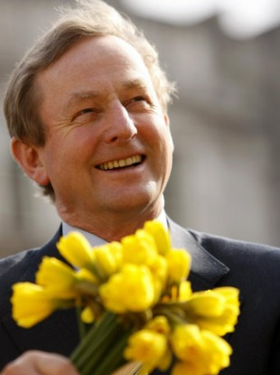 Taoiseach Enda Kenny sits by the fountain in Government Buildings during the launch of Daffodil Day in aid of the Irish Cancer Society.