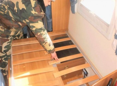 A Border Guard officer examines a place in a trailer where two hidden babies were found at checkpoint Luzhanka, Ukraine.
