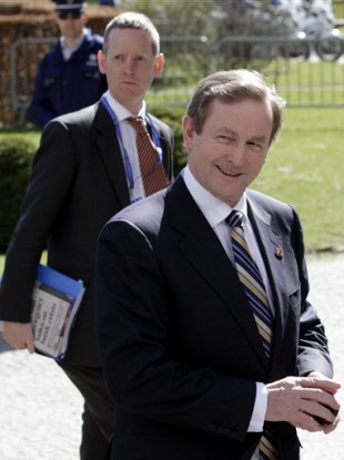 Enda Kenny arrives for a meeting of the European People's Party on the sidelines of an EU summit in Brussels, Thursday, March 24, 2011.