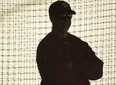 St Louis Cardinal's hitting coach Mark McGwire watches batting practice..