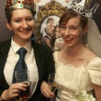 Dressed as bride and groom, Linzi Aland right, and Arwen Whiting dress the part during a royal wedding party at the Ancient Britain (the AB) hotel in Sydney, Australia, Friday, April 29, 2011. The hotel is hosting the party during celebrations for the wedding of HRH Prince William and Kate Middleton.(AP Photo/Rob Griffith)