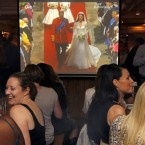 British in Hong Kong watch the Royal Wedding on TV during a party at a pub in Hong Kong Friday, April 29, 2011.
