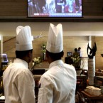 Chefs at a hotel watch a live telecast of the royal wedding on a giant screen in New Delhi, India, Friday, April 29, 2011. People gathered Friday in distant outposts of what used to be the British empire, a world of not-quite-subjects watching the wedding of Prince William, the heir to the crown. (AP Photo/Manish Swarup)