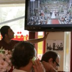 Iraqi men watch a televised broadcast in Baghdad, Iraq of the British royal wedding between Prince William and Kate Middleton, Friday, April 29, 2011. (AP Photo/Karim Kadim)
