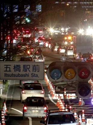 Traffic jams are seen as the traffic lights were turned out due to a blackout following a big aftershock in Sendai, northern Japan early Friday.