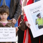 Four-year-old Edie O'Brien joins her mum and women's groups outside Leinster House Dublin today during the lunchtime protest over the recording of gardai making rape remarks after the arrest of two women protesters at the Corrib Gas Shell Protest. Pic: Julien Behal/PA Wire.