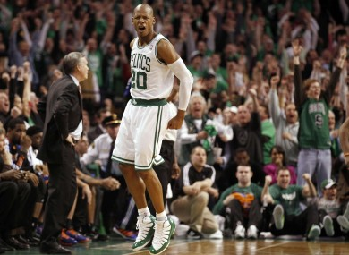 Celtics' Ray Allen celebrates after hitting the game winning three-pointer.