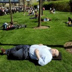 A man stretches out at City Hall, London in the warm sunny spring weather we've all enjoyed this week.