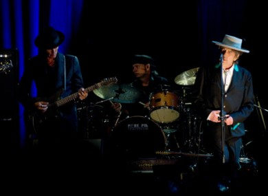 Bob Dylan and his band perform at his concert in Shanghai, China, 8 April 2011.