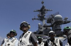 Journalists and dignitaries get a glimpse of US warship which disposed of bin Laden's body