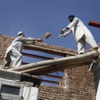 Afghan laborers pass bricks at the construction site of a house in Kabul, Afghanistan. (AP Photo/ Ahmad Nazar)