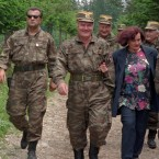 June 1996: Mladic (centre) and his wife Bisiljka walk with bodyguards through woods near the village of Han Pijesak, 60km east of Sarajevo. Bosiljka Mladic was brought in for questioning in June 2010 over weapon's found during a search of the fugitive's house