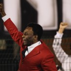 Former player Pele celebrates as Santos win the Copa Libertadores for the first tiime since the 1960s.
