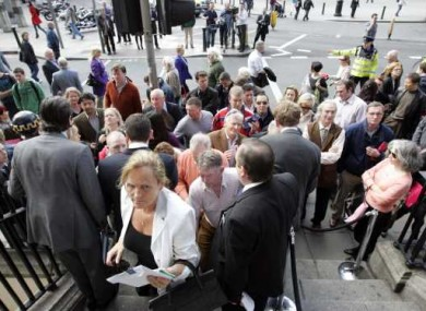 Would-be buyers queue outside the first distressed property auction at the Shelbourne in Dublin in April