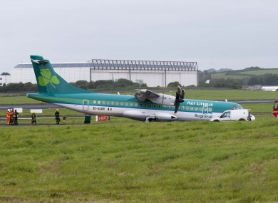 The Aer Arann aircraft, carrying Aer Lingus branding, lies just off the runway after the incident at Shannon Airport this afternoon.
