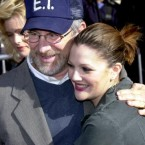 Drew Barrymore and godfather Steven Spielberg pose for the cameras. Drew's parents, grandparents and great-grandparents were all actors. At the age of 15 she sought, and won, emancipation from her parents in the courts, legally making her an independent adult.