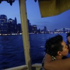 Nirvana Galvez, left, and her new wife Ruth Galvez on a cruise hosted by Marriage Equality New York in New York yesterday. (AP Photo/Seth Wenig)