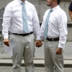 Marcos Chaljub, left, and Freddy Zambrano, hold hands after their wedding. (AP Photo/Jason DeCrow)