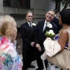 Joseph Oroza, left, and Jim Consolantis, talk to their witness, Pam Hodges, as they wait to get married. (AP Photo/Jason DeCrow)