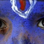 An Indian schoolboy, dressed as Hindu God Krishna, participates in a rally in support of anti-corruption activist Anna Hazare, in Allahabad, India. 