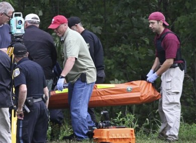 Investigators carry the body of Leonard John Egland from a wooded area in Warwick Township Pa., on Sunday Aug. 28, 2011