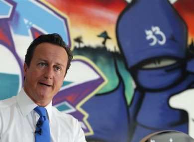 David Cameron speaks at a youth center in Witney, his Parliamentary district in southern England, Monday, Aug 15, 2011.