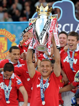 Manchester United's Nemanja Vidic lifts the Barclays Premier League trophy