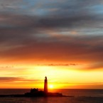 The sun rises over St Mary's Lighthouse at Whitley Bay, North Tyneside.