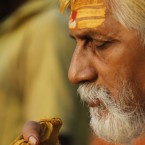 A Hindu holy man performs morning prayers after taking a dip in the River Ganges in Allahabad, India.