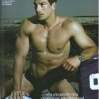 Greek rugby star Chris Fiotakis models his muscles.