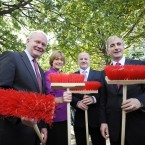 Pictured with big red brushes are Martin McGuinness, Mary Davis, Seán Gallagher and Gay Mitchell. 