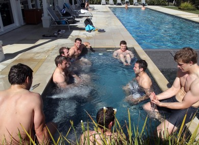 Fergus McFadden and teammates relax after training.