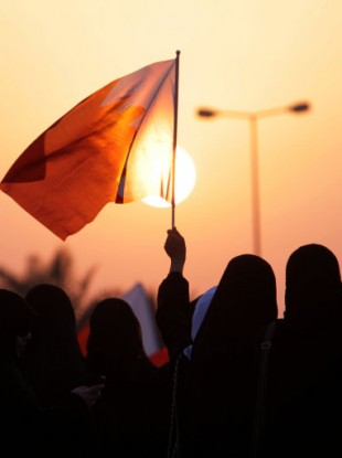 Protesters wave national flags and chant anti-government slogans during an all-women rally against alleged police brutality toward women Thursday, Sept. 29, 2011, in Miqsha, Bahrain.