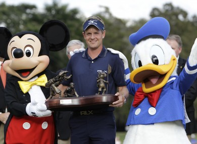 Luke Donald with Mickey Mouse, left, and Donald Duck.