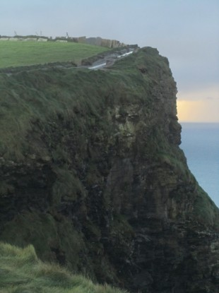 Sandra Clifford's photograph of the Cliffs of Moher featuring the apparently human image to he centre-right of the cliff front.