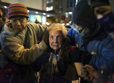 Dorli Rainey, centre, is assisted after being pepper-sprayed at the Occupy Seattle protest.
