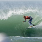 Kelly Slater surfs under the curl at the Rip Curl Pro Search surf contest en route to winning his 11th ASP season title.