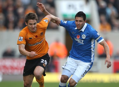 Alcaraz grapples with Kevin Doyle.