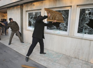 Iranian protesters break the windows of a British Embassy building, in Tehran, Iran, Tuesday, Nov. 29, 2011. 