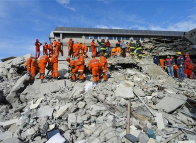 Turkish rescue workers search for survivors in the rubble of a collapsed hotel in Van, Turkey, Thursday, Nov. 10, 2011.