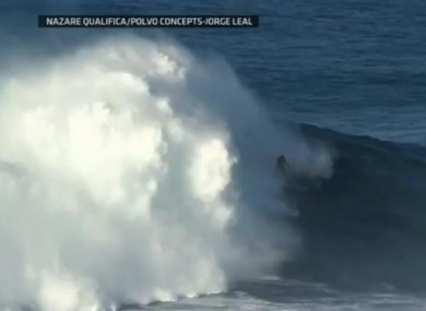Surfer Garrett McNamara riding the mammoth wave in Portugal yesterday