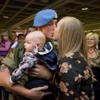 James Dunne is welcomed home by his girlfriend Lorraine Collins and his son Andrew (4 and a half months) at Dublin. Photo: Laura Hutton/Photocall Ireland