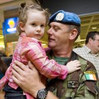 Martin White is welcomed home by his daughter Aoibhe (aged 3) at Dublin Airport this. Photo: Laura Hutton/Photocall Ireland