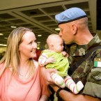 Derek Carlin is welcomed home by his daughter Kaylah (3 months) and wife Nicola at Dublin Airport this . Photo: Laura Hutton/Photocall Ireland