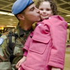 Michael Conway is welcomed home by his daughter Kate (aged 4) at Dublin Airport. Photo: Laura Hutton/Photocall Ireland