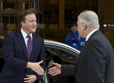 David Cameron shakes hands with Polish premier Donald Tusk arriving in Brussels last night. Talks broke up in the early hours without unanimous agreement.